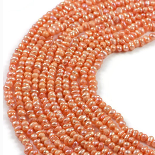 AqBeadsUk Freshwater Crystal Energy Pearl with Natural Healing Power - Premium Genuine Cultured 4-5mm Dyed Light Orange Pearl Rice Jewellery Making Beads on 15.5 inch 2 Strands
